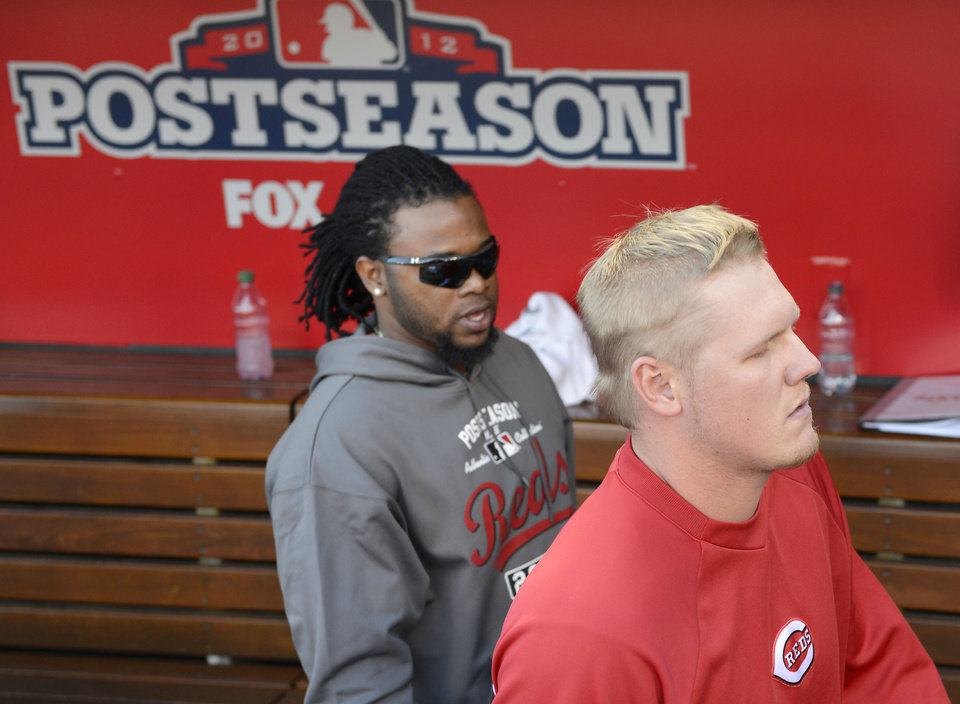 Photo -   Cincinnati Reds starting pitcher Mat Latos, right, leaves the dugout with pitcher Johnny Cueto after the Giants defeated the Reds 6-4 in Game 5 of the National League division baseball series, Thursday, Oct. 11, 2012, in Cincinnati. The Giants won the final three games, all in Cincinnati, and advanced to the NL championship series. (AP Photo/Michael Keating)