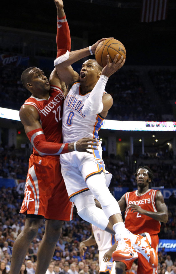 Photo - Oklahoma City's Russell Westbrook (0) shoots a lay up as Houston's Dwight Howard (12) defends during the NBA game between the Oklahoma City Thunder and Houston Rockets at the  Chesapeake Energy Arena  in Oklahoma City, Okla., Tuesday, March 11, 2014. Photo by Sarah Phipps, The Oklahoman