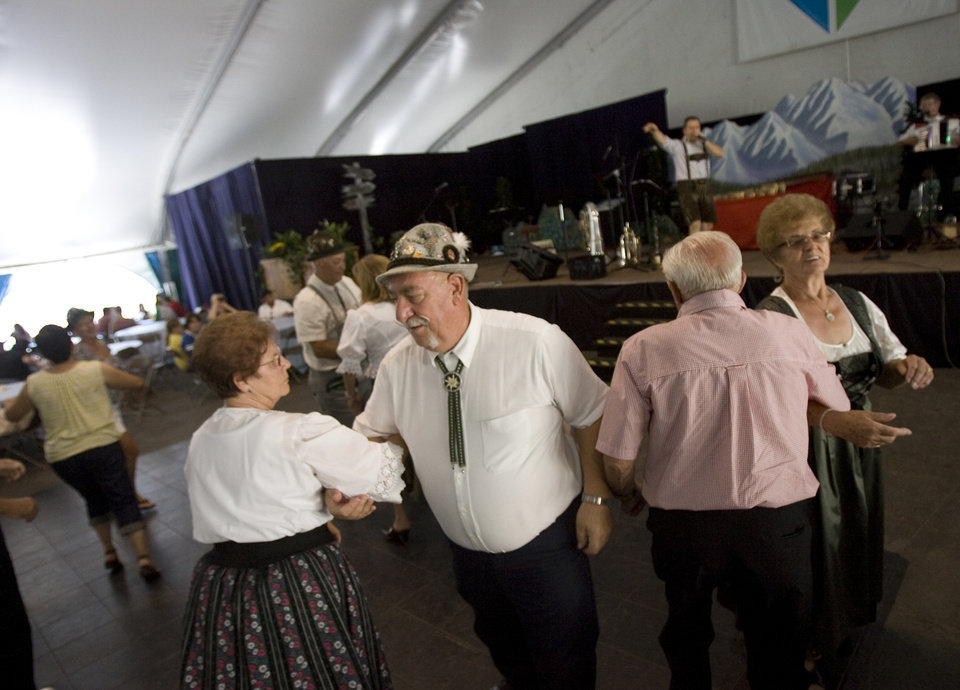 Photo - FILE - In this Aug. 18, 2012, file photo, people dance as Salzburger Echo performs traditional music during Snowbird's 40th annual Oktoberfest Celebration at Snowbird Ski Resort in Utah. The beer will flow at the Utah Oktoberfest, after the state liquor board backed off its warning that the German celebration of all things ale could go dry this year. Utah's state liquor board on Tuesday, June 24, 2014,  voted unanimously to grant a license for Snowbird Ski Resort's 12-week event now in its fourth decade. (AP Photo/The Salt Lake Tribune, Kim Raff, File)  DESERET NEWS OUT; LOCAL TV OUT; MAGS OUT