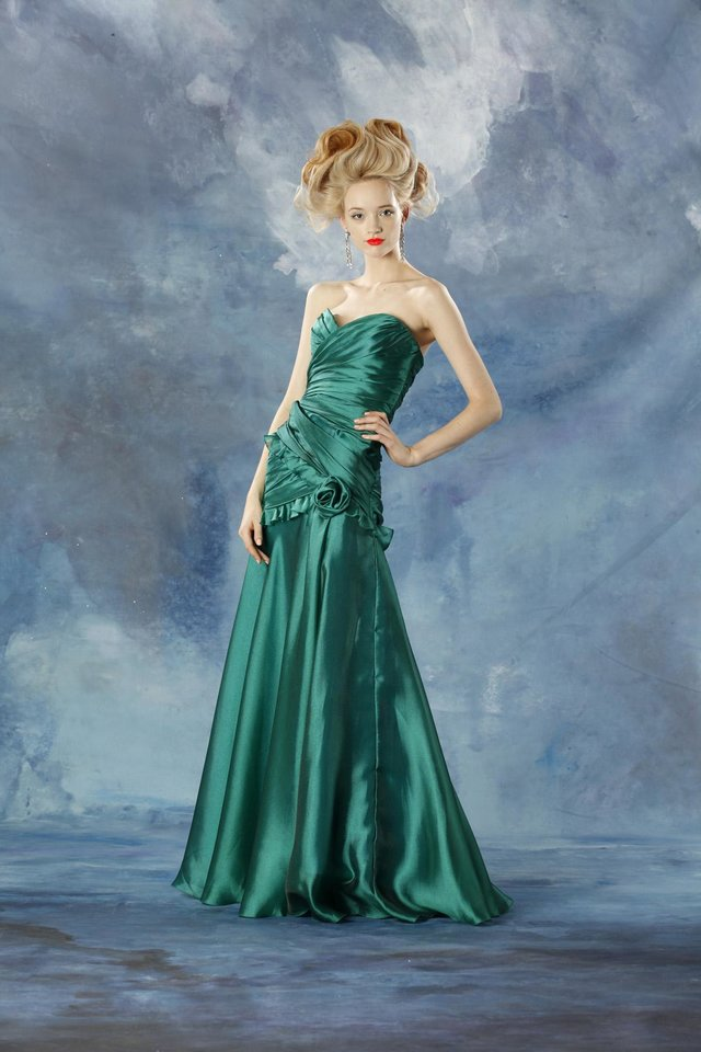 "Theia celebrates the ""color of 2013"" - emerald green - with an elegant gown designed with goddesses in mind."