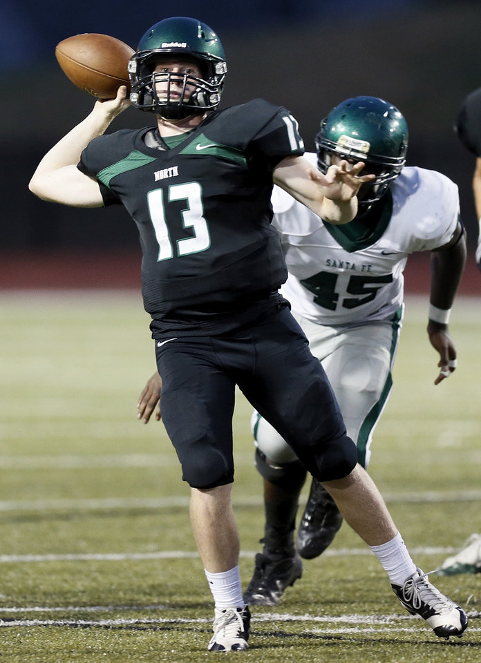 Photo - Norman North's Peyton Gavras (13) passes during a high school football scrimmage at Moore Stadium between Edmond Santa Fe and Norman North in Moore, Okla., Thursday, Aug. 16, 2012. Photo by Nate Billings, The Oklahoman