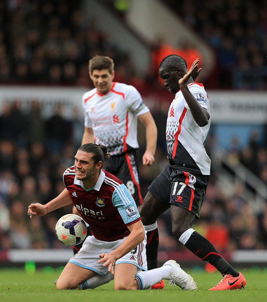 Photo - Liverpool's Mamadou Sakho (right) and West Ham United's Andy Carroll (left) battle for the ball  during their English Premier League match at Upton Park, London,  Sunday, April 6, 2014.   (AP Photo / Nick Potts,PA)  UNITED KINGDOM OUT  NO SALES  NO ARCHIVE