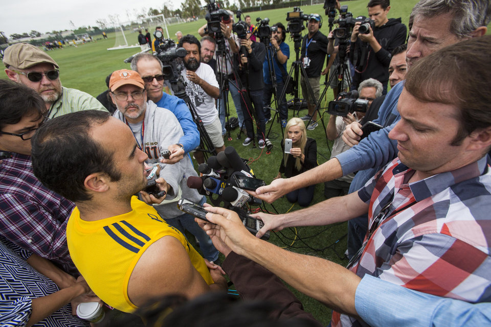 Photo - Los Angeles Galaxy forward Landon Donovan talks to media after a soccer training session at StubHub Center in Carson, Calif., Saturday, May 24, 2014.  Donovan, the most accomplished American player in the history of men's soccer, won't be going to his fourth World Cup. The 32-year-old attacker was among seven players cut Thursday when coach Jurgen Klinsmann got down to the 23-man limit well before the June 2 deadline. (AP Photo/Ringo H.W. Chiu)