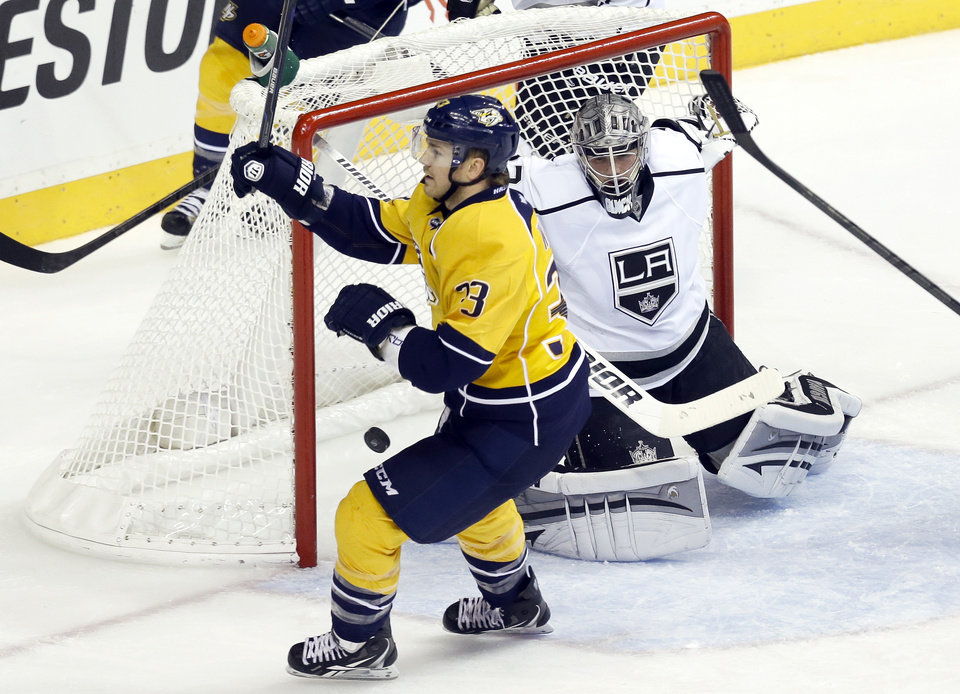Nashville Predators center Colin Wilson (33) scores against Los Angeles Kings goalie Jonathan Quick in the second period of an NHL hockey game, Thursday, Feb. 7, 2013, in Nashville, Tenn. (AP Photo/Mark Humphrey)