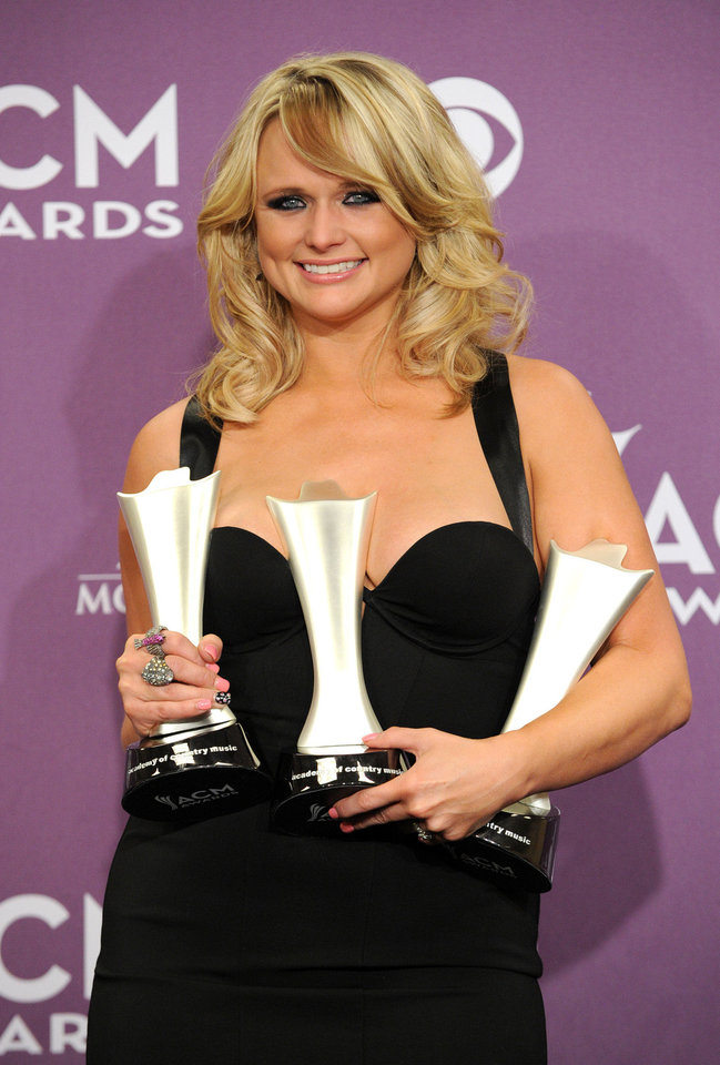 "Miranda Lambert poses backstage with the awards for song of the year and single record of the year for ""Over You"" and female vocalist of the year at the 48th Annual Academy of Country Music Awards at the MGM Grand Garden Arena in Las Vegas on Sunday, April 7, 2013. (Photo by Al Powers/Invision/AP) ORG XMIT: NVPM355 <strong>Al Powers - Al Powers/Invision/AP</strong>"