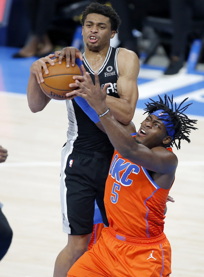 Photo - Oklahoma City's Luguentz Dort (5) and San Antonio's Keldon Johnson (3) fight for the ball during an NBA basketball game between the Oklahoma City Thunder and the San Antonio Spurs at Chesapeake Energy Arena in Oklahoma City, Tuesday, Jan. 12, 2021.  San Antonio won 112-102. [Bryan Terry/The Oklahoman]