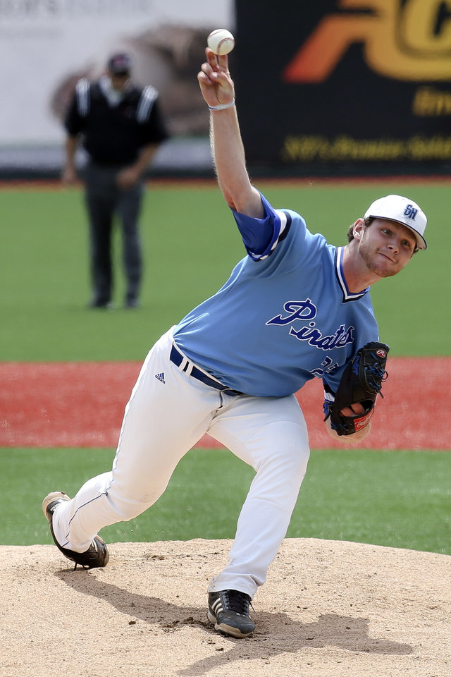 Photo - Seton Hall pitcher Luke Cahill pitches against Creighton in the first inning of their NCAA college baseball game in the Big East tournament, Saturday, May 24, 2014, in New York. Creighton won 2-1. (AP Photo/John Minchillo)