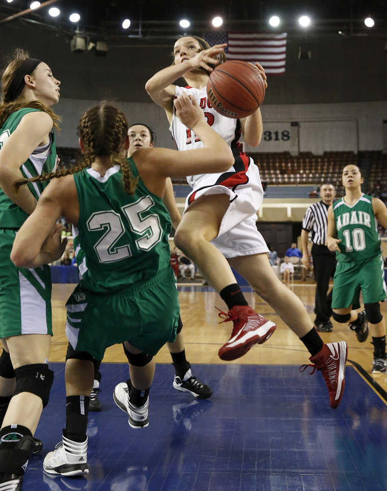 Adair's Molly Kerr (25) draws a charge from Ashley Hughes during the 3A girls semifinal game between the Adair High School Lady Warriors and the Sulphur Lady Bulldogs at the State Fair Arena on Friday, March 8, 2013 in Oklahoma City, Okla.  Photo by Steve Sisney, The Oklahoman