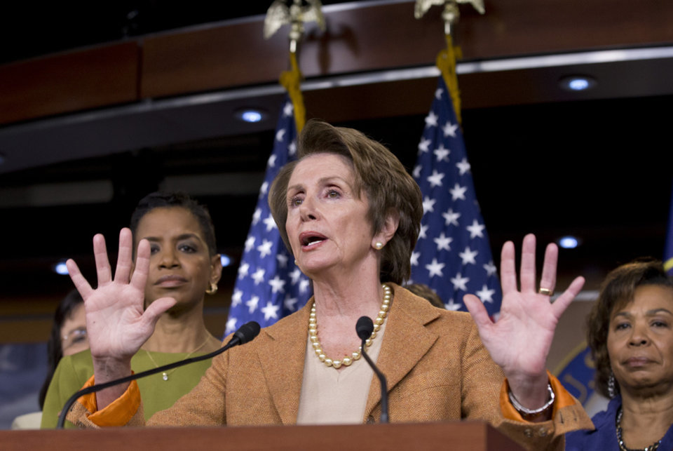 House Minority Leader Nancy Pelosi of Calif., joined by House Democratic women, gestures during a news conference on Capitol Hill in Washington, Thursday, Feb. 28, 2013, to talk  about the impending automatic spending cuts that take effect March 1. (AP Photo/J. Scott Applewhite)