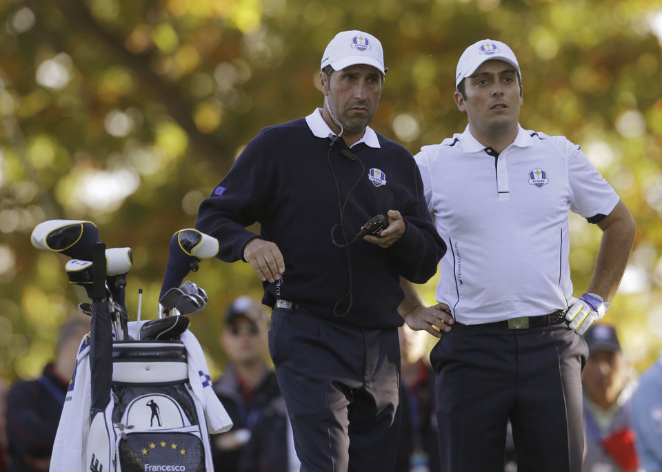 European team captain Jose Maria Olazabal, left, talks to Francesco Molinari on the 17th tee during a singles match at the Ryder Cup PGA golf tournament Sunday, Sept. 30, 2012, at the Medinah Country Club in Medinah, Ill. (AP Photo/Chris Carlson)  ORG XMIT: PGA187