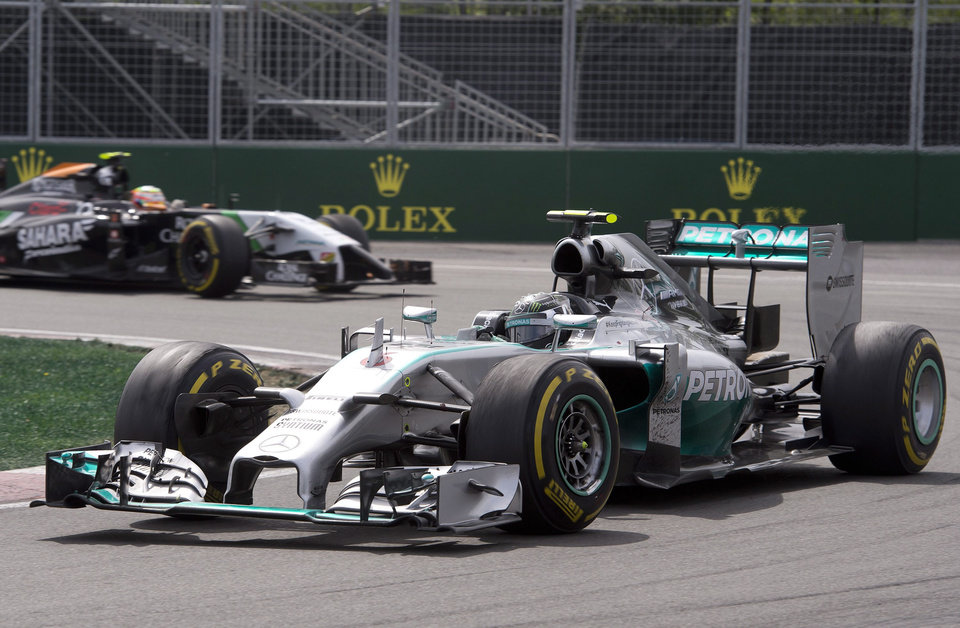 Photo - Mercedes driver Nico Rosberg from Germany races to a second-place finish during the race Sunday, June 8, 2014, at the Canadian Grand Prix in Montreal. Force India driver Nico Hulkenberg from Germany is behind. (AP Photo/The Canadian Press, Jacques Boissinot)