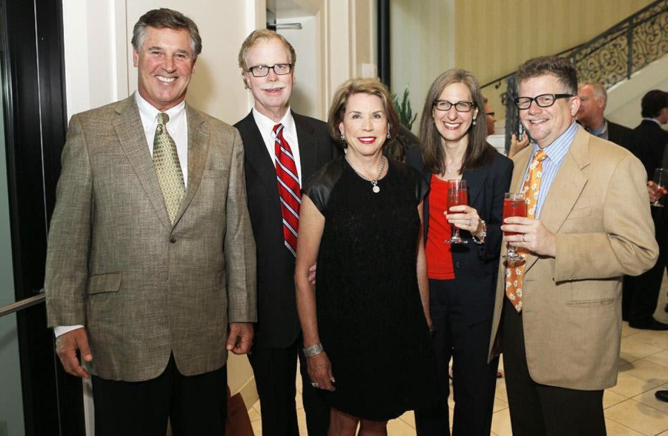 Photo - Rob Northwood, Nick and Peggy Duncan, Amy Middleman and husband Larry Heyman pose for a photo during a reception for