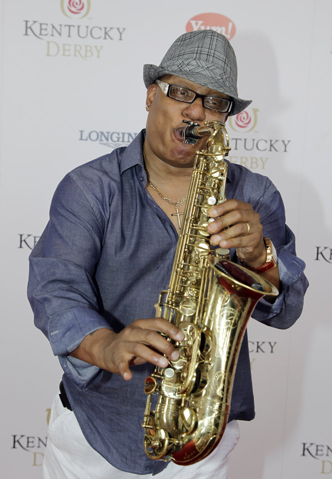 Photo - Grammy winner Ski Johnson plays the saxophone on arrival for the 138th Kentucky Derby horse race at Churchill Downs Saturday, May 5, 2012, in Louisville, Ky. (AP Photo/Darron Cummings)  ORG XMIT: DBY156