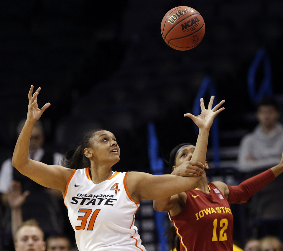Photo - Oklahoma State's Kendra Suttles (31) forces a turnover from Iowa State's Seanna Johnson (12) during the Women's Big 12 basketball tournament at  Chesapeake Energy Arena  in Oklahoma City, Okla., Saturday, March 8, 2014. Photo by Sarah Phipps, The Oklahoman