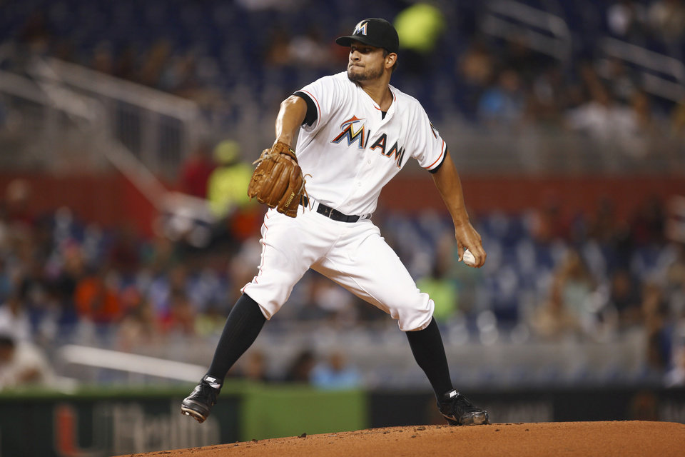 Photo - Miami Marlins' Brad Hand pitches to the Arizona Diamondbacks during the first inning of a baseball game in Miami, Friday, Aug. 15, 2014. (AP Photo/J Pat Carter)