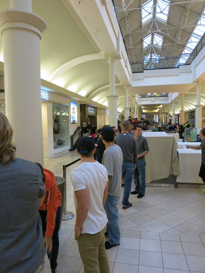 Photo - People waiting in line for the new iPhones at Penn Square Mall in Oklahoma City.
