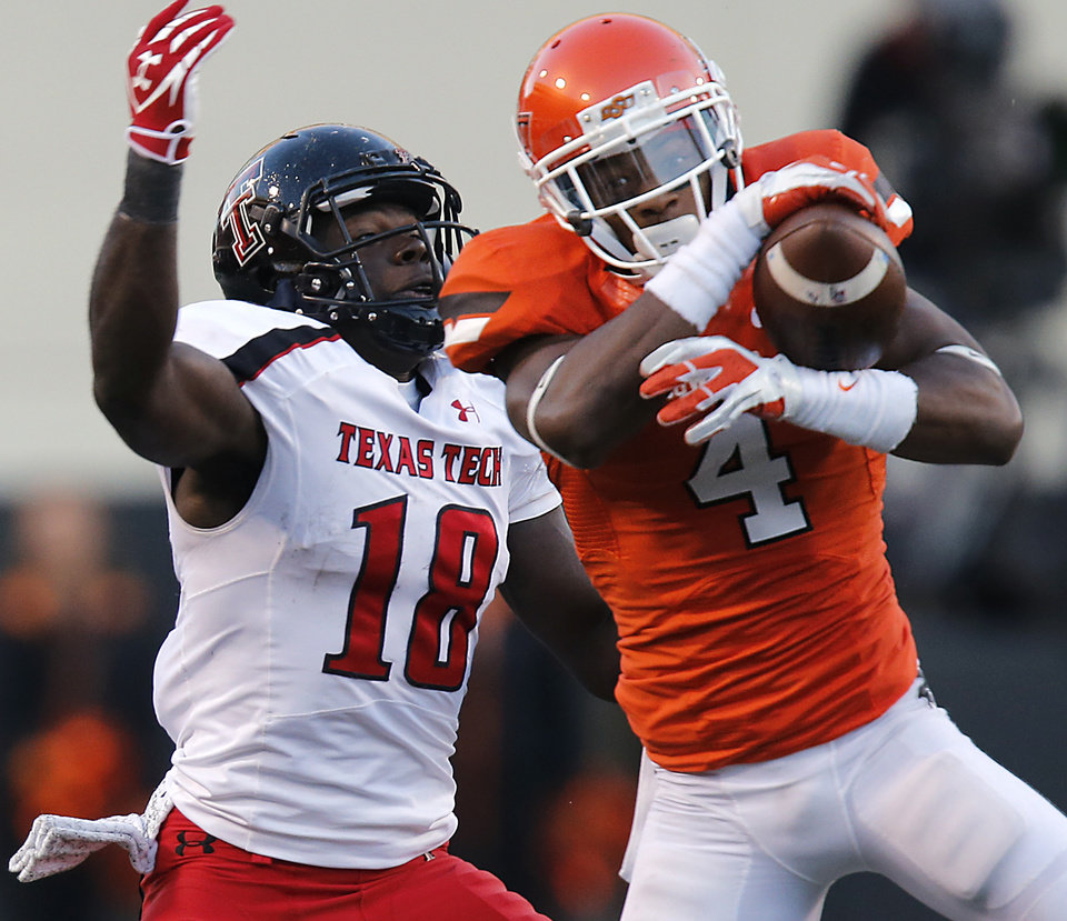 Photo - Oklahoma State's Justin Gilbert (4) breaks up a pass to Texas Tech's Eric Ward (18) during the college football game between the Oklahoma State University Cowboys (OSU) and Texas Tech University Red Raiders (TTU) at Boone Pickens Stadium on Saturday, Nov. 17, 2012, in Stillwater, Okla.   Photo by Chris Landsberger, The Oklahoman