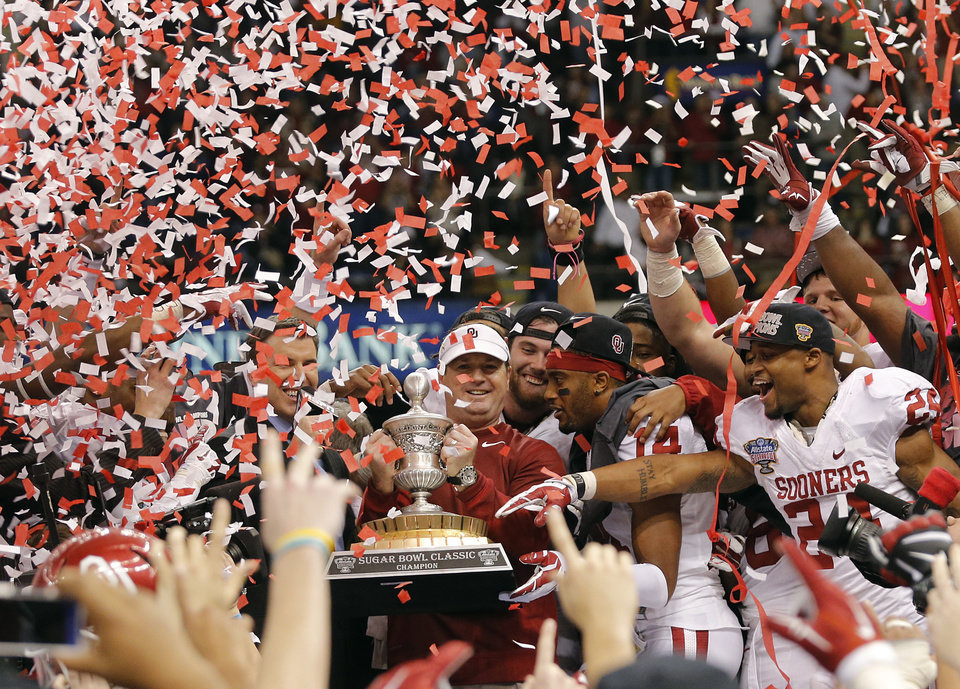 Photo - Bob Stoops and the Sooners celebrate the 45-31 win over Alabama during the NCAA football BCS Sugar Bowl game between the University of Oklahoma Sooners (OU) and the University of Alabama Crimson Tide (UA) at the Superdome in New Orleans, La., Thursday, Jan. 2, 2014.  .Photo by Chris Landsberger, The Oklahoman