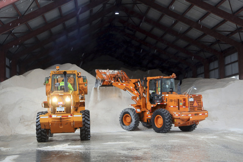 Photo - Sanitation workers use tractors to pile up salt at a depot, Friday, Feb. 8, 2013 in New York. A storm poised to dump up to 3-feet of snow from New York City to Boston and beyond beginning Friday could be one for the record books, forecasters warned, as residents scurried to stock up on food and water and road crews readied salt and sand. (AP Photo/Mary Altaffer)