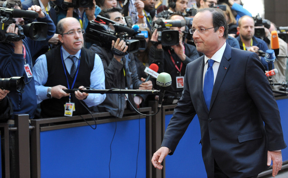 Photo - French President Francois Hollande, right, arrives for an EU summit in Brussels on Thursday, March 20, 2014. The EU Commission president wants a two-day summit of European Union leaders to center on boosting the fledgling government in Kiev rather than focus exclusively on sanctions against Russia over its annexation of Ukraine's Crimea peninsula. (AP Photo/Eric Vidal)