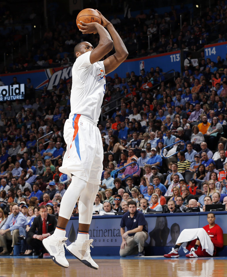 Photo - Oklahoma City's Serge Ibaka (9) takes an open shot during an NBA basketball game between the Oklahoma City Thunder and the Portland Trailblazers at the Chesapeake Energy Arena in Oklahoma City, Monday, March 14, 2016. Photo by Nate Billings, The Oklahoman