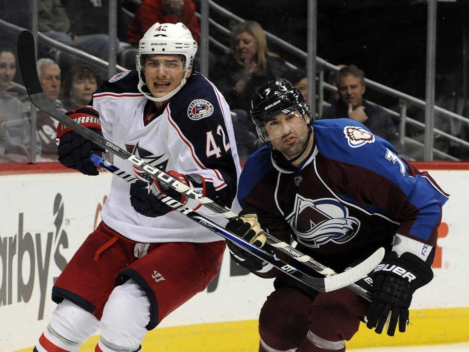 Photo - Columbus Blue Jackets center Artem Anisimov (42), from Russia, and Colorado Avalanche defenseman Ryan O'Byrne (3) look on during the second period of an NHL hockey game on Thursday, Jan. 24, 2013, in Denver. (AP Photo/Jack Dempsey)