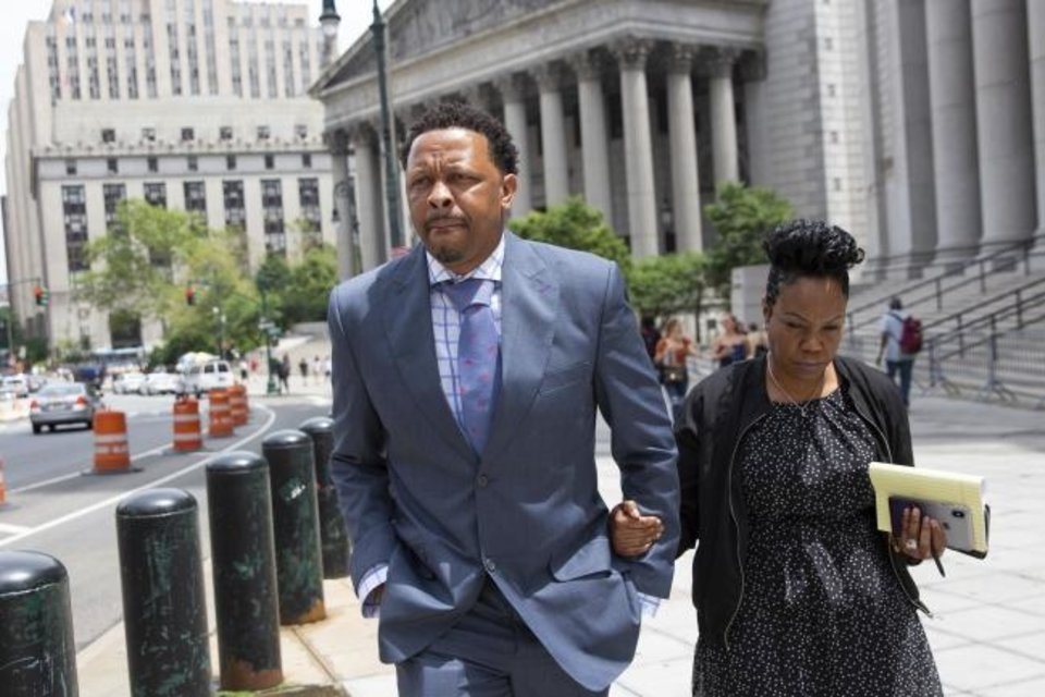 Photo -  Former Oklahoma State assistant basketball coach Lamont Evans leaves after his sentencing in Federal Court Friday, in New York. Evans is one of four convicted in a scheme to pay coaches and families of top-tier players to choose favored managers and financial advisors. [AP Photo/Kevin Hagen]