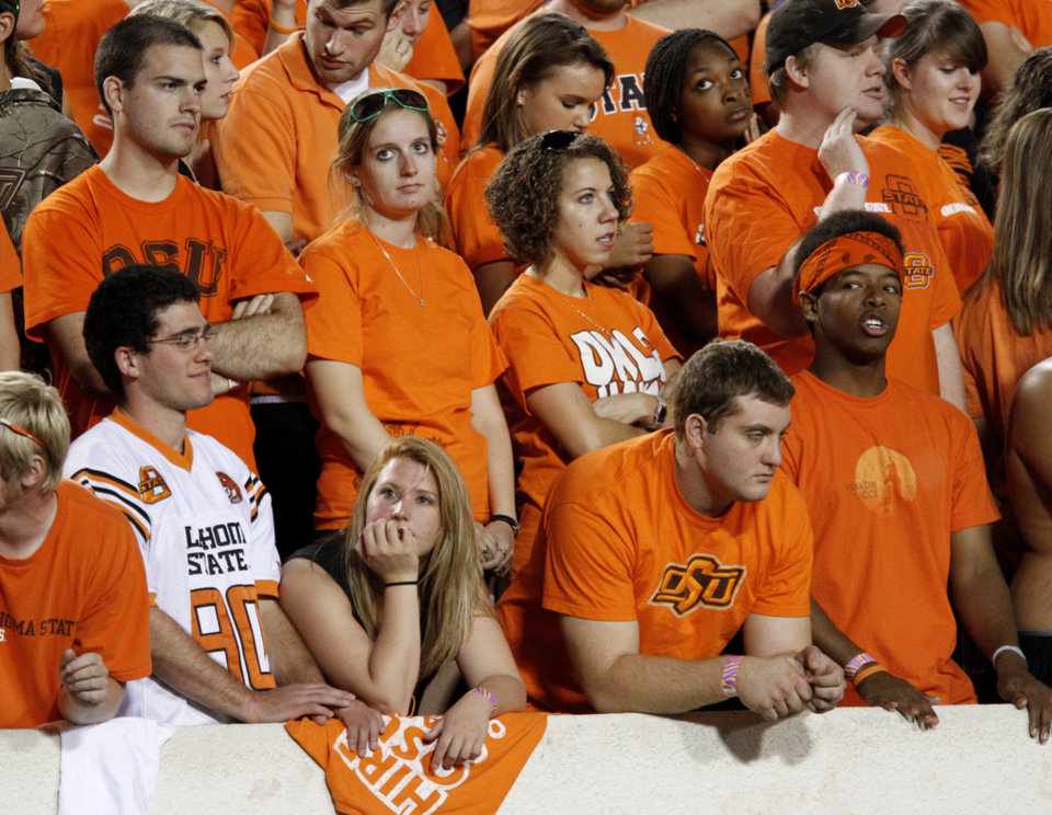 Photo - OSU fans react after a Texas A&M touchdown during the college football game between Texas A&M University and Oklahoma State University (OSU) at Boone Pickens Stadium in Stillwater, Okla., Thursday, Sept. 30, 2010. Photo by Bryan Terry, The Oklahoman