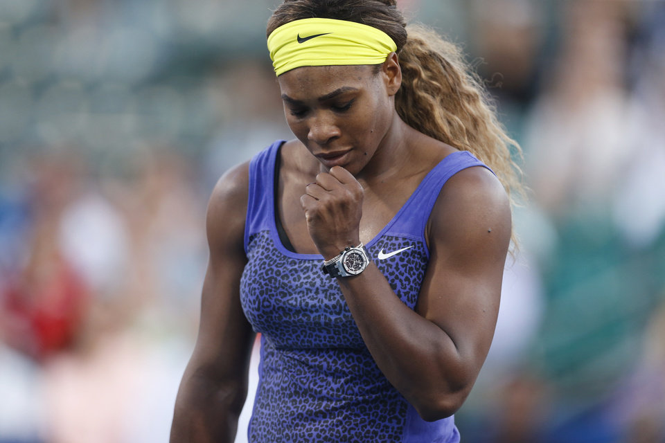 Photo - Serena Williams reacts after scoring a point during the second set of her match against Karolina Pliskova in the Bank of the West Classic, Wednesday, July 30, 2014, in Stanford, Calif. (AP Photo/Beck Diefenbach)