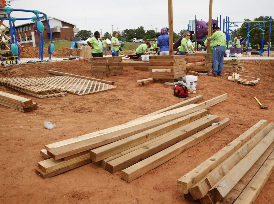 Organizers said about 140 volunteers from Partners in Public Health, Blue Cross and Blue Shield of Oklahoma, organizers from KaBOOM! and residents of the Oklahoma City community will provided the labor on Saturday, June 8, 2013, to build a new playground at the Northeast Regional Health and Wellness Center on NE 63 Street, east of MLK Blvd. The new playground\'s design is based on drawings created by children who participated in a Design Day event in April. Photo by Jim Beckel, The Oklahoman.