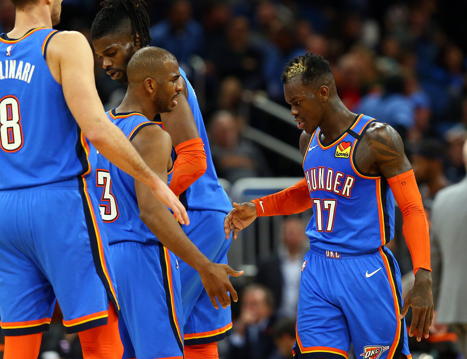 Photo - Jan 22, 2020; Orlando, Florida, USA; Oklahoma City Thunder guard Dennis Schroder (17) is congratulated by guard Chris Paul (3) and center Nerlens Noel (9) against the Orlando Magic during the second half at Amway Center.  [Kim Klement/USA TODAY Sports]