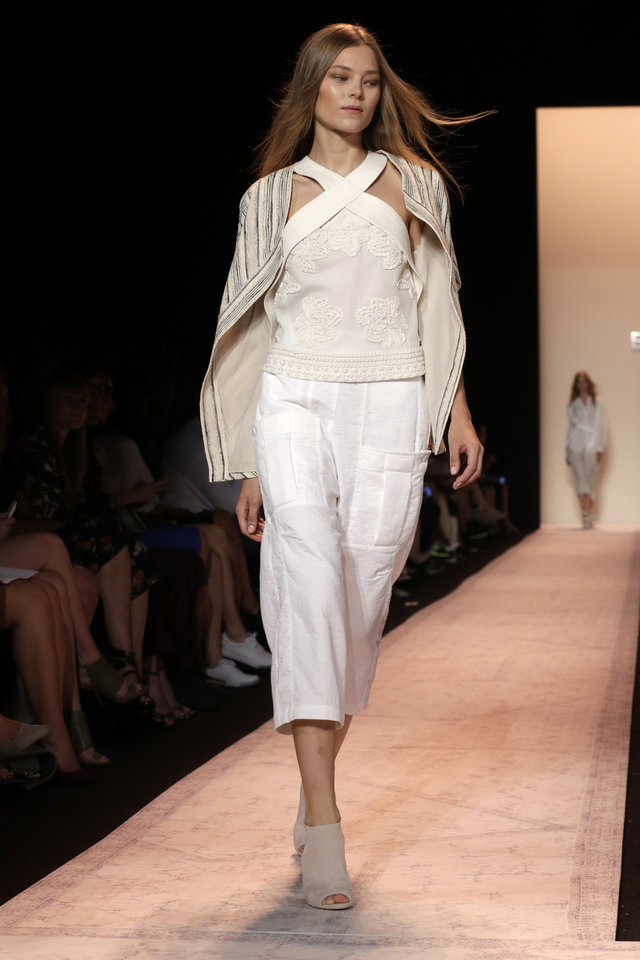 Photo - The BCBG MAX AZRIA Spring 2015 collection is modeled during Fashion Week in New York, Thursday, Sept. 4, 2014. (AP Photo/Richard Drew)