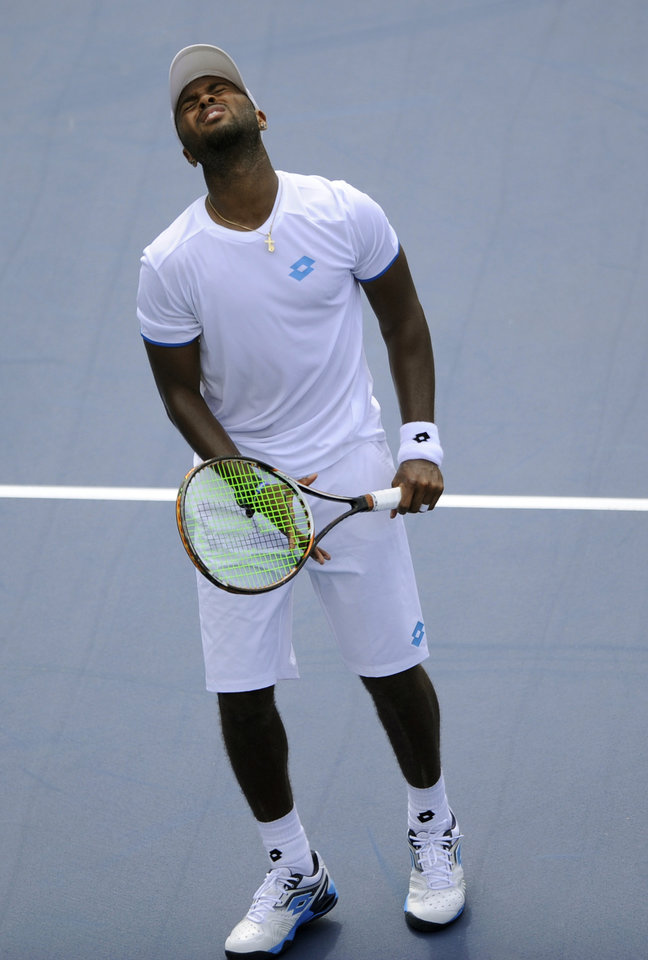 Photo - Donald Young reacts during a match against Milos Raonic, of Canada, at the Citi Open tennis tournament, Saturday, Aug. 2, 2014, in Washington. Raonic won 6-4, 7-5. (AP Photo/Nick Wass)