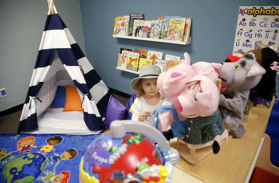 Photo -  Evelynn Farris, 4, plays in a room for children inside Palomar. [Photo by Bryan Terry, The Oklahoman]