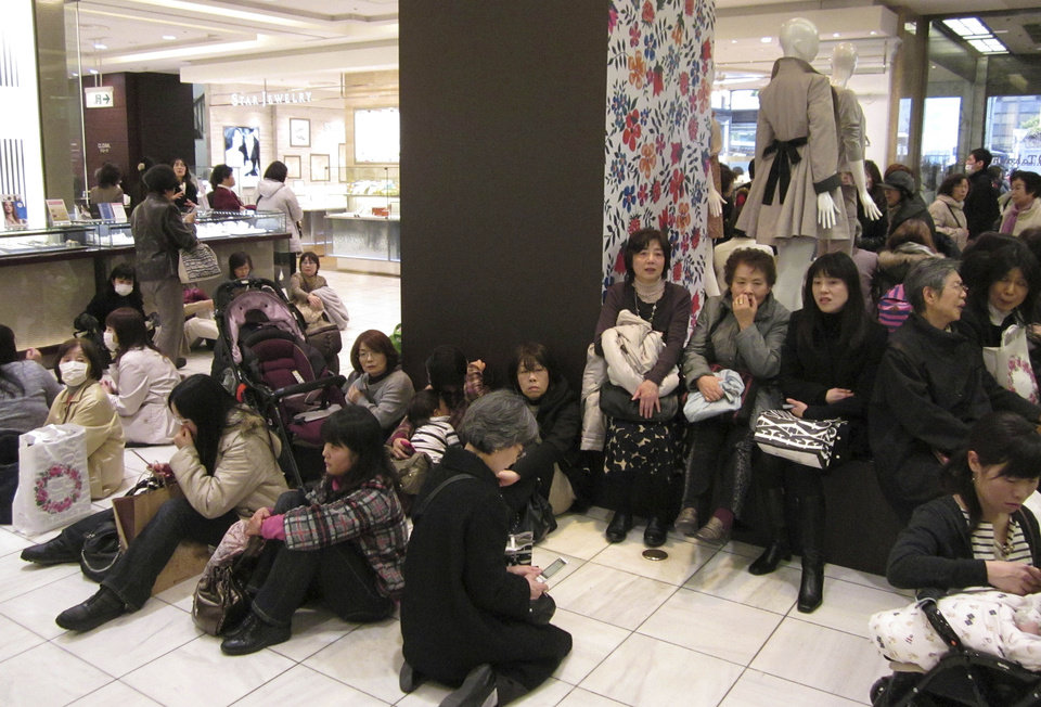 Photo - Stranded shoppers sit on the floor of a department store as train and bus services were suspended due to a strong earthquake in Yokohama, near Tokyo on Friday, March 11, 2011. (AP Photo/Shuji Kajiyama) ORG XMIT: XKAJ105