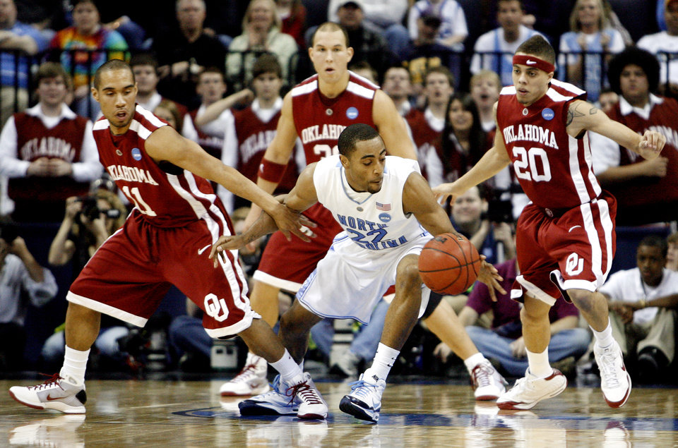 Photo - North Carolina's Wayne Ellington (22) gets past the defense of Oklahoma's Omar Leary (11) and Austin Johnson (20) during the first half in the Elite Eight game of NCAA Men's Basketball Regional between the University of North Carolina and the University of Oklahoma at the FedEx Forum on Sunday, March 29, 2009, in Memphis, Tenn.