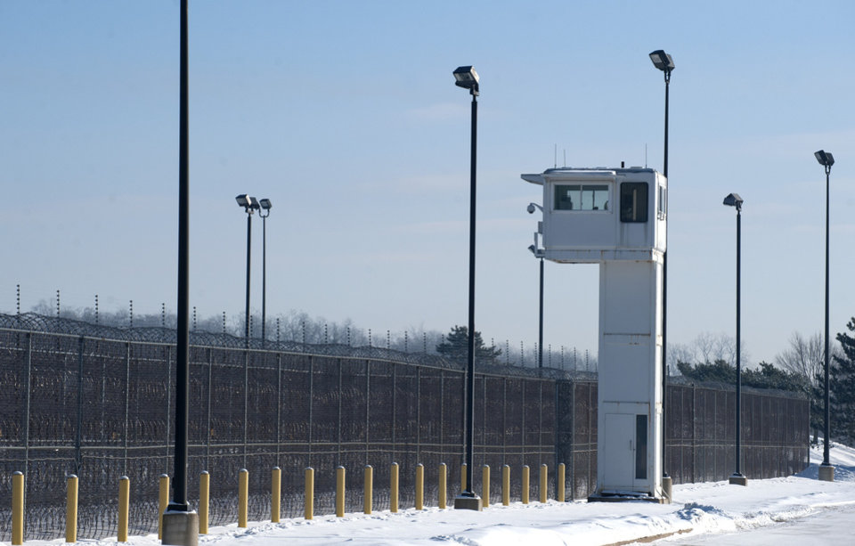 Photo - A guard tower stands over fencing at the Ionia Correctional Facility Monday, Feb. 3, 2014.  A national manhunt is underway for convicted killer Michael Elliot  who escaped from the prison on Sunday. (AP Photo/The Grand Rapids Press, Chris Clark) ALL LOCAL TV OUT; LOCAL TV INTERNET OUT