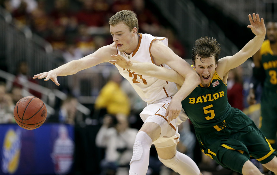 Photo - Texas' Connor Lammert (21) and Baylor's Brady Heslip (5) chase a loose ball during the first half of an NCAA college basketball game in the semifinals of the Big 12 Conference tournament on Friday, March 14, 2014, in Kansas City, Mo. (AP Photo/Charlie Riedel)