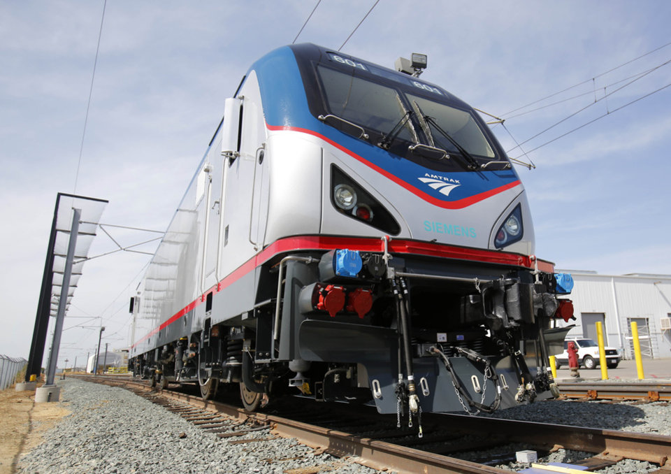 Photo - In this photo taken Saturday, May 11, 2013, is one of the new Amtrak Cities Sprinter Locomotives built by Siemens Rails Systems in Sacramento, Calif.  The new electric locomotive, one of three of 70 to be built,  will run on the Northeast intercity rail lines and  replace Amtrak locomotives that have been in service for 20 to 30 years.(AP Photo/Rich Pedroncelli)