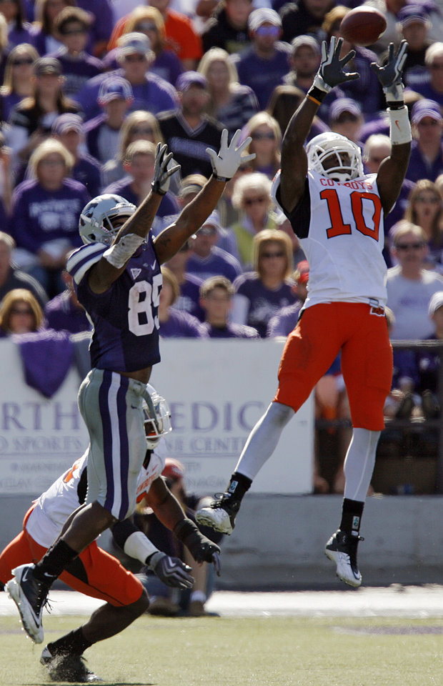 Photo - Oklahoma State's Markelle Martin (10) makes an interception in front of Kansas State's Zach Trujillo (85) during the second half of the college football game between the Oklahoma State University Cowboys (OSU) and the Kansas State University Wildcats (KSU) on Saturday, Oct. 30, 2010, in Manhattan, Kan.   Photo by Chris Landsberger, The Oklahoman