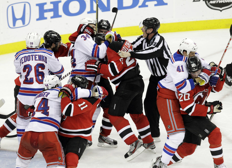 Photo -   New York Rangers players fight with New Jersey Devils players during the third period of Game 4 of an NHL hockey Stanley Cup Eastern Conference final playoff series, Monday, May 21, 2012, in Newark, N.J. The Devils won 4-1. (AP Photo/Kathy Willens)
