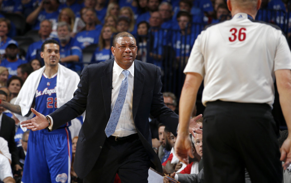 Photo - Clippers coach Doc Rivers reacts after a technical foul was calledduring Game 2 of the Western Conference semifinals in the NBA playoffs between the Oklahoma City Thunder and the Los Angeles Clippers at Chesapeake Energy Arena in Oklahoma City, Wednesday, May 7, 2014. Photo by Bryan Terry, The Oklahoman