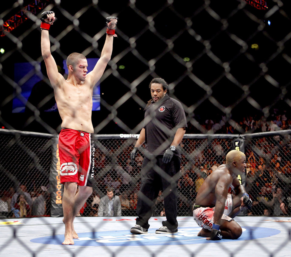 Photo - CELEBRATION: Nate Diaz, left, celebrates after beating Melvin Guillard during UFC Fight Night at the Cox Convention Center in Oklahoma City, Wednesday, September 16, 2009.  Photo by Bryan Terry, The Oklahoman ORG XMIT: KOD