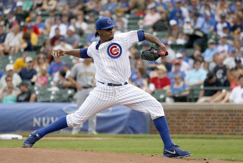 Photo - Chicago Cubs starting pitcher Edwin Jackson delivers during the first inning of a baseball game against the Pittsburgh Pirates, Friday, June 20, 2014, in Chicago. (AP Photo/Charles Rex Arbogast)