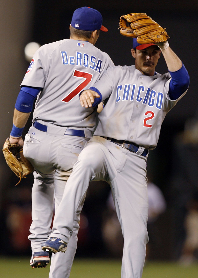 Photo - Chicago Cubs' third baseman Mark DeRosa, left, celebrates with shortstop Ryan Theriot after the Cubs' 10-2 victory over the Colorado Rockies in a Major League baseball game in Denver on Thursday, Aug. 9, 2007.  (AP Photo/David Zalubowski) ORG XMIT: DXF116