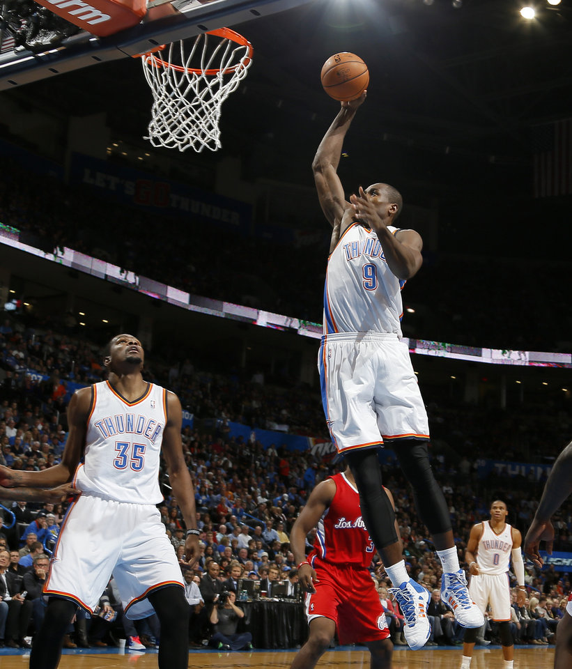 Oklahoma City's Serge Ibaka (9) goes to the basket during an NBA basketball game between the Oklahoma City Thunder and the Los Angeles Clippers at Chesapeake Energey Arena in Oklahoma City, Thursday, Nov. 21, 2013. Photo by Bryan Terry, The Oklahoman