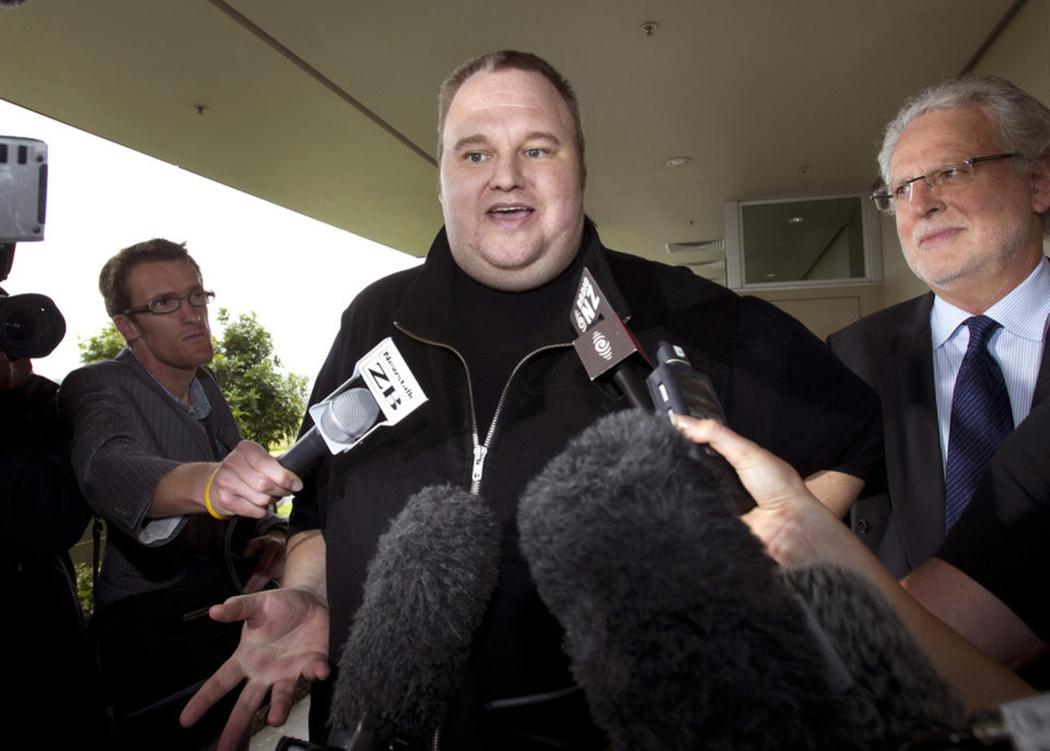 FILE - In this Feb. 22, 2012 file photo, Kim Dotcom, the founder of the file-sharing website Megaupload, comments after he was granted bail and released in Auckland, New Zealand. Indicted Megaupload founder Kim Dotcom has launched a new file-sharing website in a defiant move against the U.S. prosecutors who accuse him of facilitating massive online piracy. The colorful entrepreneur unveiled the