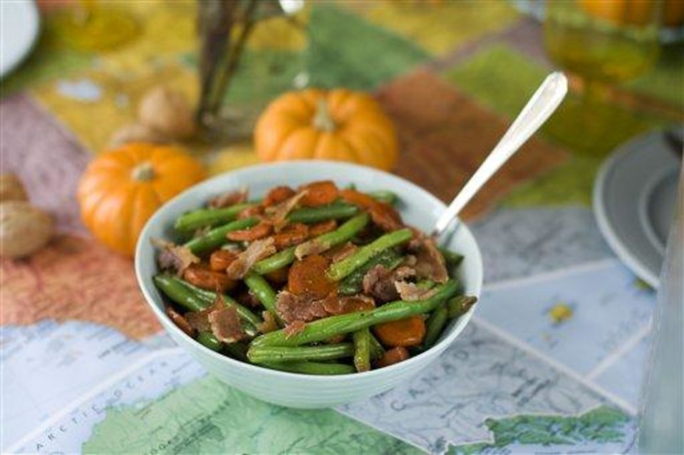 In this image taken on Oct. 2, 2012, sweet-and-sour glazed carrots and green beans are shown in a serving bowl in Concord, N.H. (AP Photo/Matthew Mead)