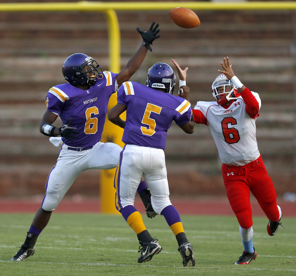Photo - Northwest Classen's Corbin Richardson, left, tips the ball over teammate Jimmy Reece, to Western Heights' Tim Tulles for a touchdown during a high school football game at Taft Stadium in Oklahoma City, Thursday, September 20, 2012. Photo by Bryan Terry, The Oklahoman