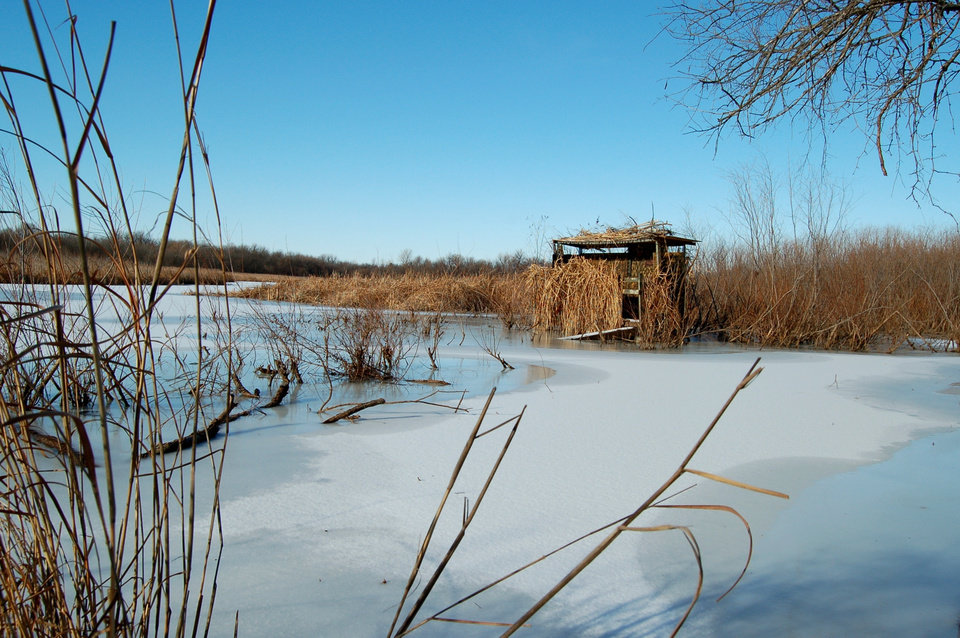 Ice surrounding a duck blind in the Stinchcomb Wildlife Preserve north of the old Overholser bridge.<br/><b>Community Photo By:</b> Eldon<br/><b>Submitted By:</b> Eldon, Bethany